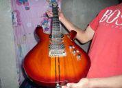 Se vende cualquiera de estas dos guitarras electricas profesionales personalizadas que tie
