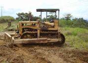 Se alquila tractor a oruga para carreteras.